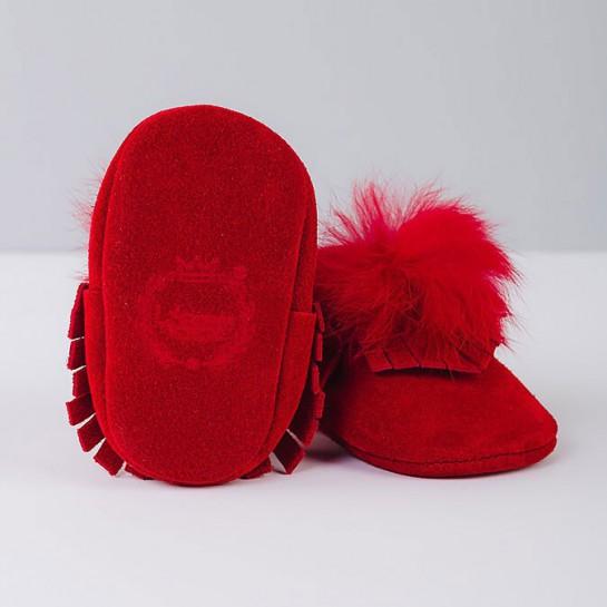 Red moccasins with pom-pom